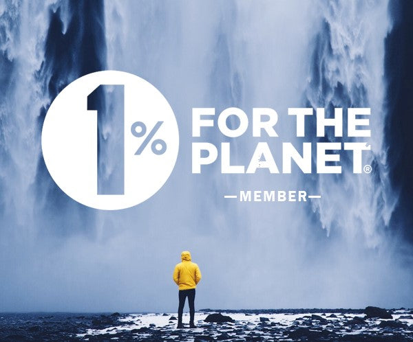 1% for the Planet - man standing in front of a big waterfall