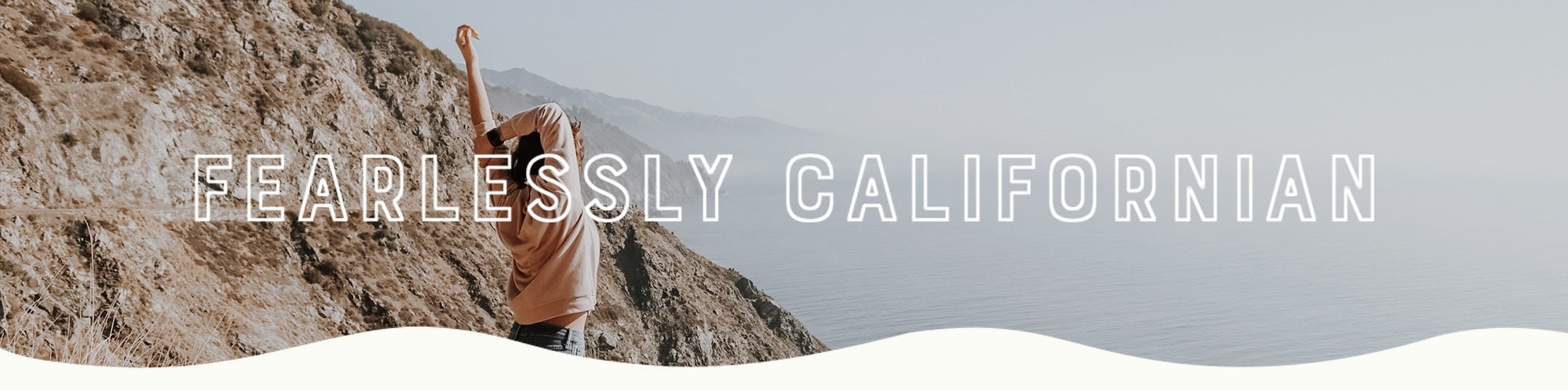 Fearlessly Californian - woman stretching in the mountains overlooking the sea