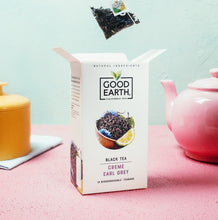 Load image into Gallery viewer, Good Earth Crème Earl Grey Tea Bag Above Open Package