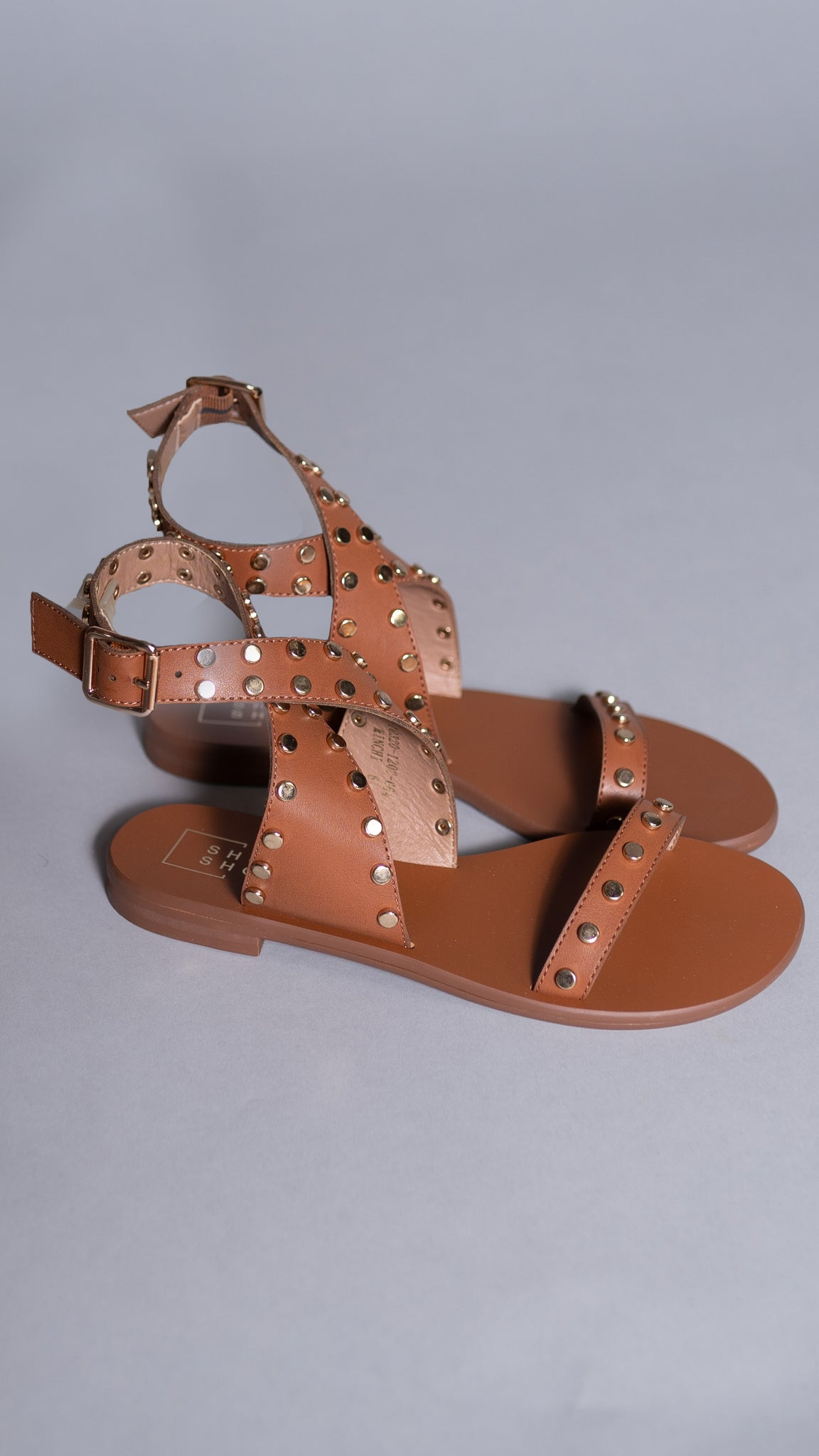 brown gladiator sandals with gold stud accents from Rosa Lee Boutique