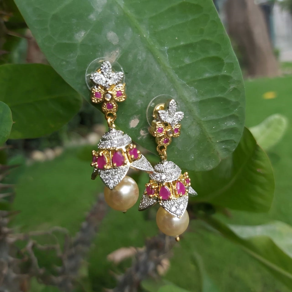 Golden plated Jhumka earrings with pearl drop and ruby stones on stud-740022
