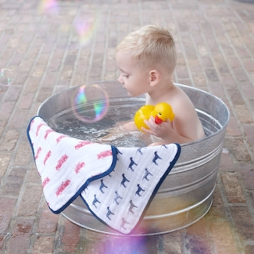 Our generously sized 100% plush cotton washcloths are a bath time essential. Featuring an attached loop for quick drying and colorful prints for bath time fun.