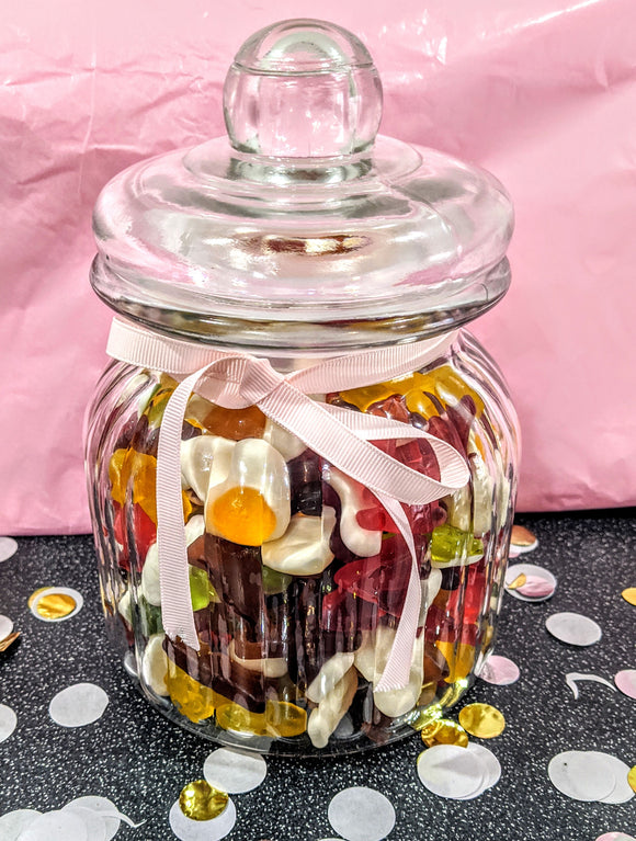 Glass 14cm jar full of sweets.