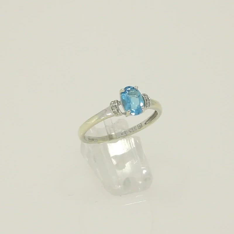 Pre Owned 9ct White Gold Diamond And Blue Topaz Dress Ring Video