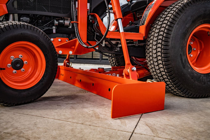 Close up view of straight grader blade in orange