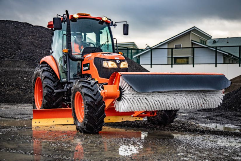 Kubota tractor low down view with broom