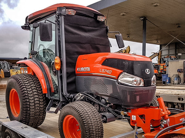Orange Kubota L5740 Tractor with windscreen protector