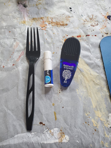 fork, chapstick, and clip