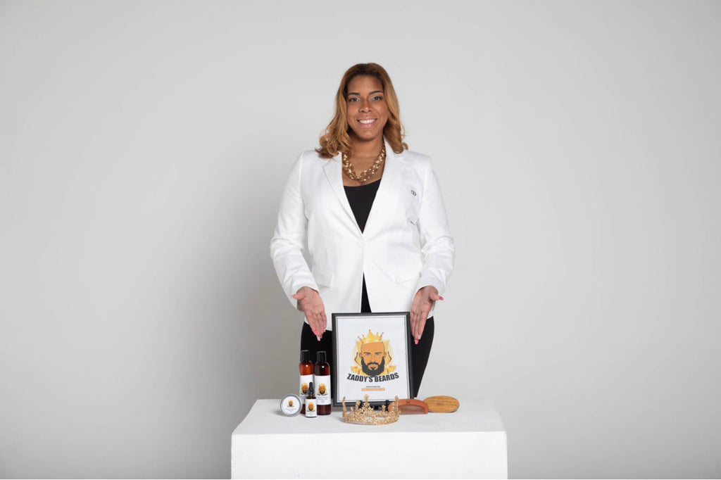 Kim Duplessis White Blazer with products up front