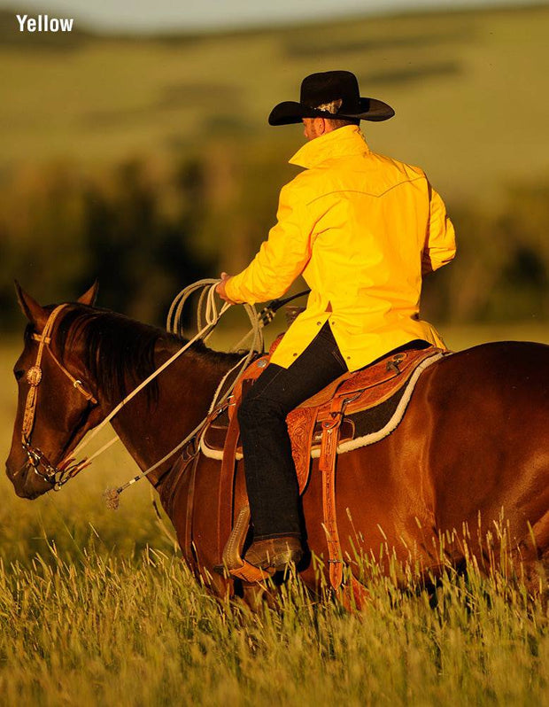 Cowboy on horseback wearing Stockman Drifter Jacket in Yellow