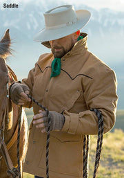 Cowboy wearing Legacy Drifter Coat in Saddle (light brown)