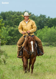 Cowboy on horseback wearing Fenceline Arena Jacket in Suntan (light brown)