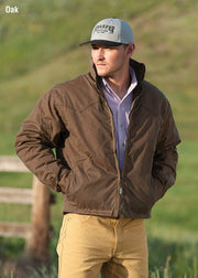 Cowboy wearing RangeWax Arena Jacket in Oak (brown)
