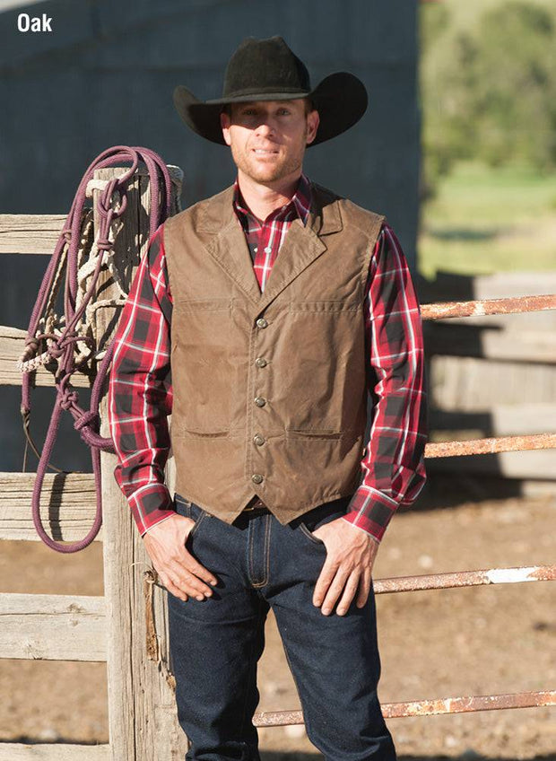 Cowboy wearing RangeWax Ranger Vest in Oak (brown)