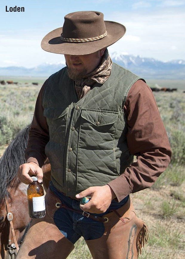 Cowboy wearing Blacktail Quilted RangeWax Vest in Loden (green)