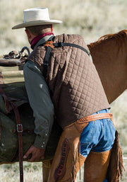 Cowboy wearing Blacktail Quilted RangeWax Vest in Oak (brown)