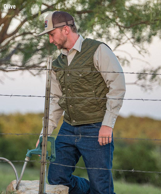 Cowboy wearing Bridger Vest in Olive (green)