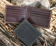 Caprock Bison Bi-Fold Wallet in Black and Brown, shown opened