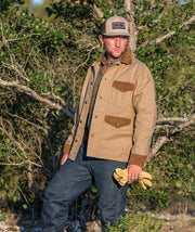 Cowboy wearing The Official Trucker hat in Heather Khaki