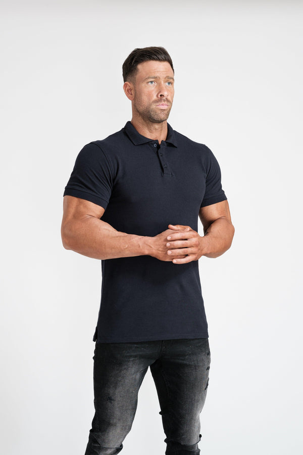 Short Sleeve Navy Muscle Fit Polo Shirt For Men. A Proportionally Fitted and Tight Polo Shirt. Ideal for muscular guys.