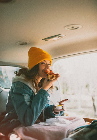 Eating pizza in car