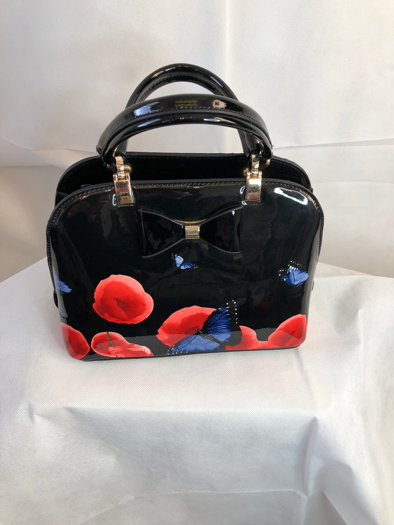 Small Black Paten Bag with Bow Accessory and Floral Poppy Pattern