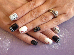Embrace the black and white nail trend