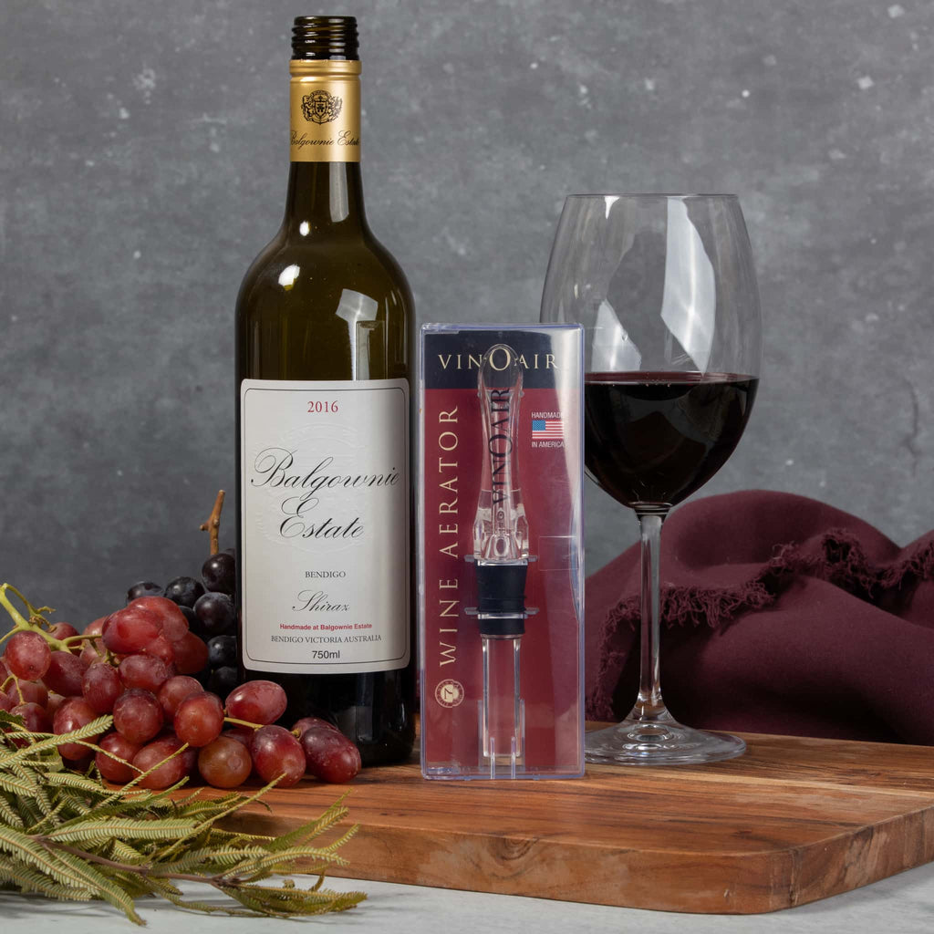 VinOair wine aerator with bottle and grapes