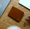 A beautiful and stylish bi-fold wallet that sorts your notes and coins like magic