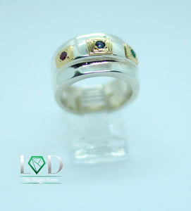 Three natural stones of .10 carats each, set in a geometric design on a band of 950 silver and 18 karat gold decorations.