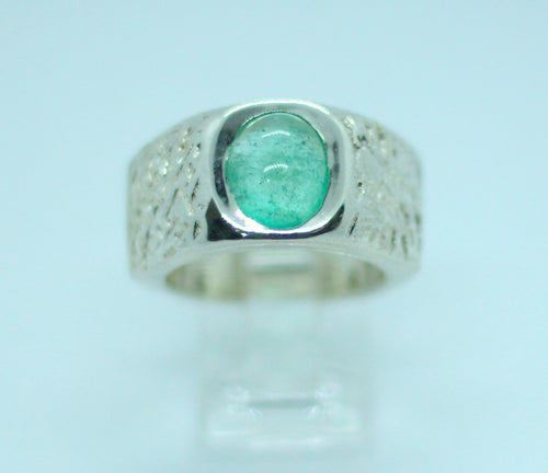 A 1 cm thick textured 950 silver band set with a 4-carat mint green Colombian emerald.  A unisex statement ring.