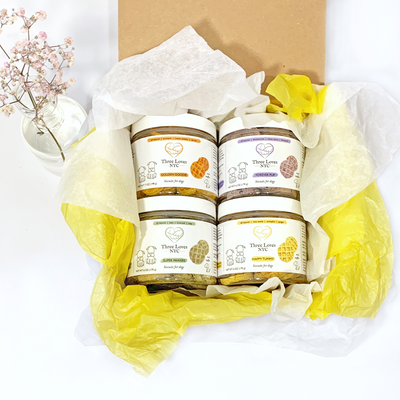 4 Jars of organic Mini Waffle dog treats in an eco-friendly gift box packaging
