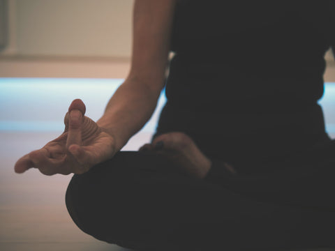 woman sitting in lotus pose meditates