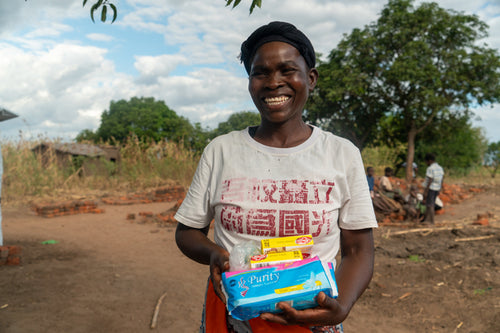 Agness Jackson, of Mandawala village, Secretary for the community development committee, is happy to be one of the beneficiaries of the intervention, Chanda village, Zomba, Malawi, July, 2019.