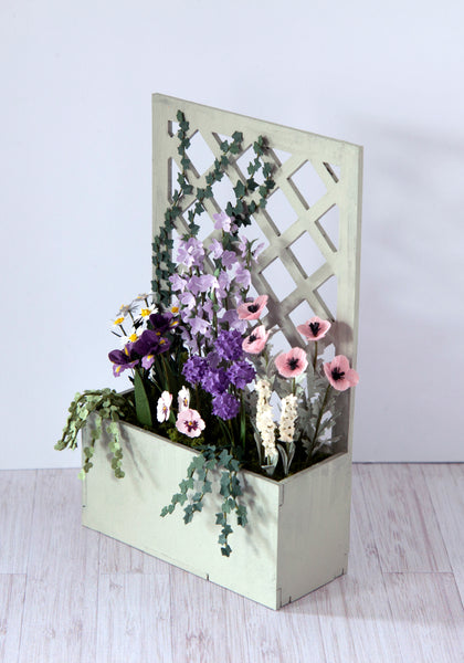 12th Scale Trellis backed Planter filled with Summer flowers in pink, purple, mauve and white