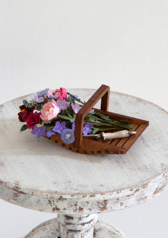 12th Scale Artisan Wooden Flower Basket filled with summer flowers in pinks, mauves and a garden trowel