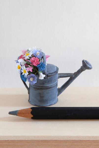 12th Scale Artisan Watering can filled with white, pink and blue summer flowers