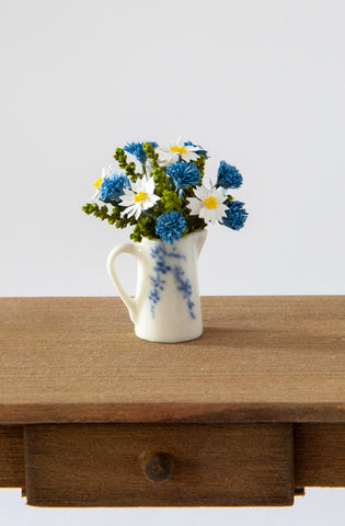 12th Scale Hand Made Cornflowers and Shasta Daises in a white ceramic jug with blue flower decoration
