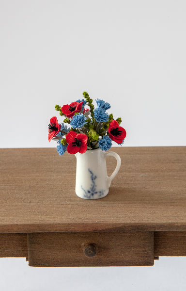12th Scale Hand Made Cornflowers and Poppies in a white ceramic jug with blue flower decoration