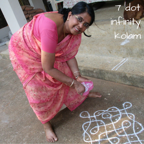 drawing a kolam in the morning