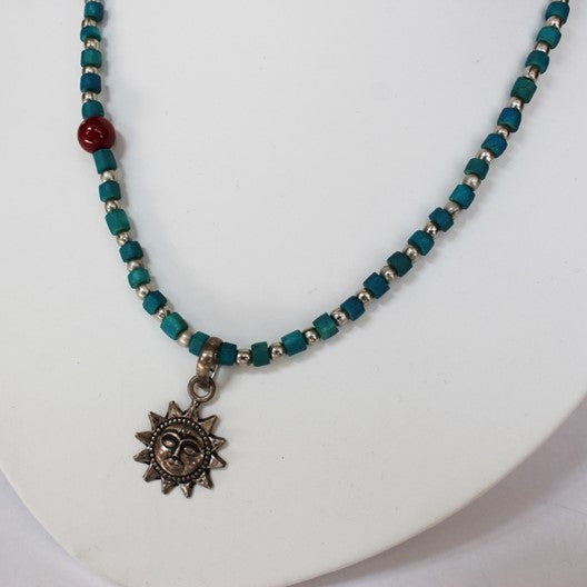 blue drishti necklace with sun pendant