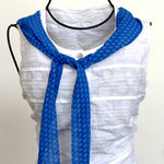 long and narrow blue scarf