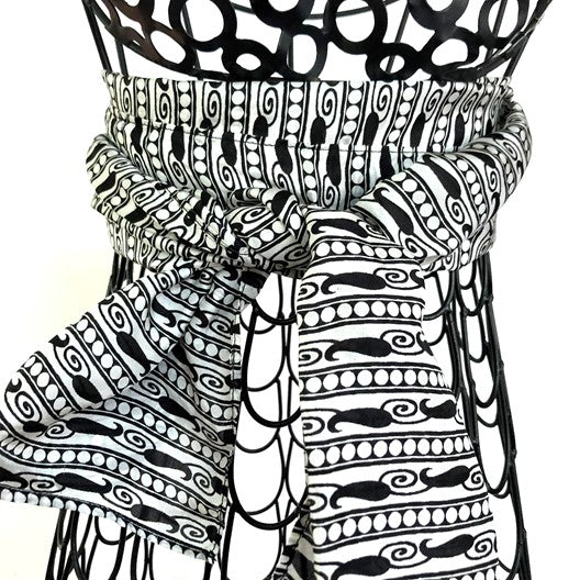 white silk scarf with black paisleys