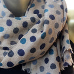 tan wool scarf with polka dots in blues and grays