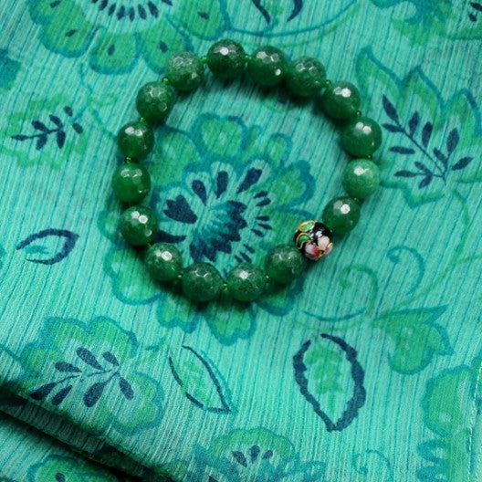 emerald green scarf and green bracelet