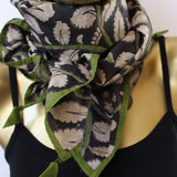 black kalamkari scarf with leaf motifs