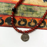 evil eye necklace orange agate and black drishti bead