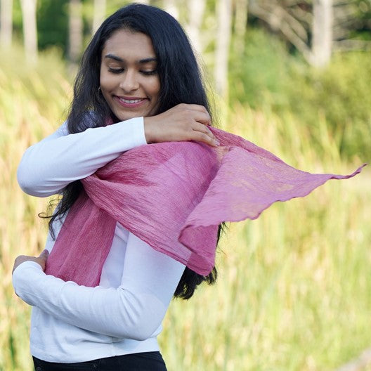 girl wearing pink Mayil scarf
