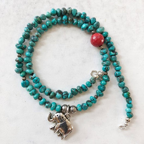 evil eye necklace with turquoise and coral bead