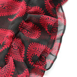 black scarf with red paisleys